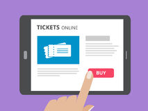 Hand touching screen of tablet computer with buy button and tickets icon on screen. Concept of online tickets mobile. Application. Flat design vector Royalty Free Stock Image