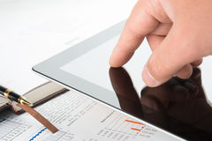 Hand touching screen of tablet pc Royalty Free Stock Photo