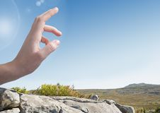Hand Touching sky in landscape Stock Photos