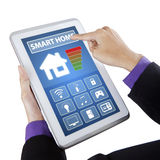 Hand touching smart home controller on tablet Royalty Free Stock Images