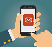 Hand touching smart phone with Email symbol on the screen. Using smartphone similar to iphone, flat design concept. Eps 10 vector Royalty Free Stock Photo