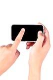 Hand touching smartphone Stock Photo
