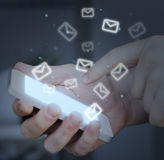 Hand touching smartphone. Mail concept. Royalty Free Stock Photography