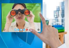 Hand touching Social Video Chat App Interface with woman holding binoculars. Digital composite of Hand touching Social Video Chat App Interface with woman Stock Photography