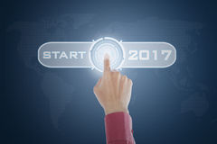 Hand touching start button with 2017 Royalty Free Stock Images
