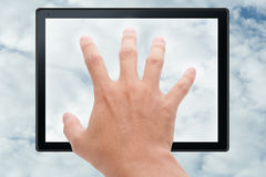 Hand touching tablet in cloud Royalty Free Stock Photography