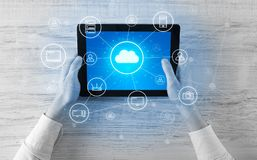 Hand using tablet with centralized cloud computing system concept. Hand touching tablet with cloud computing and online storage concept stock images