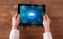 Hand using tablet with centralized cloud computing system concept. Hand touching tablet with cloud computing and online storage conceptn royalty free stock photography