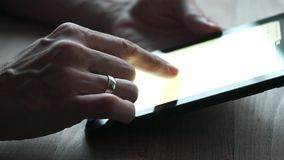 Hand touching tablet computer. Surface touchscreen stock video footage