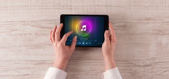 Hand holding tablet with music play concept. Hand touching tablet with music play  conceptn royalty free stock image
