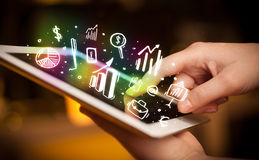 Hand touching tablet pc, charts concept Stock Photography