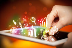 Hand touching tablet pc, charts concept Royalty Free Stock Photography