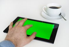 Hand touching tablet pc. Royalty Free Stock Photo