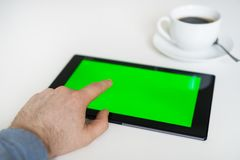 Hand touching tablet pc. Stock Photo