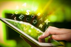 Finger pointing on tablet pc, letters concept Stock Photography