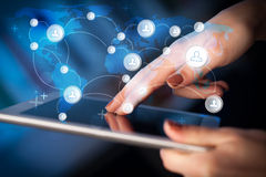 Hand touching tablet pc, social network concept Stock Image