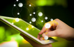 Hand touching tablet pc, social network concept Stock Photography