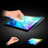 Hand is touching tablet pc to make gesture. Man hand is touching tablet pc to make gesture. Variant on dark background Stock Image