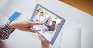 Hand touching tablet PC while video conferencing Royalty Free Stock Images