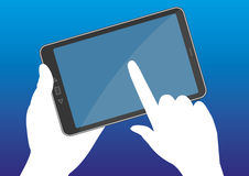 Hand touching the tablet's display Royalty Free Stock Images