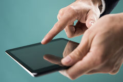 Hand touching the tablet Royalty Free Stock Photos