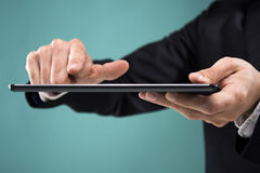 Hand touching the tablet Stock Photos