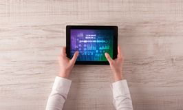 Hand holding tablet with sound design concept. Hand touching tablet with waveforms and sound design concept stock photo