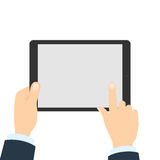 Hand touching tablet. White tablet with blank template screen. Finger touching screen Royalty Free Stock Images