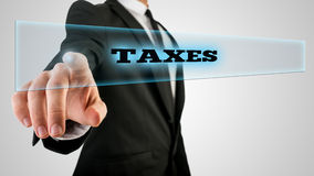Hand Touching Taxes Box on Touch Screen Royalty Free Stock Photography