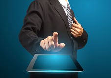 Hand touching the touch screen of tablet. Computer pc Stock Image