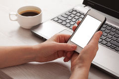 Hand touching touch smart phone on the workplace, social media concept Royalty Free Stock Photography