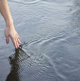 Hand touching water Royalty Free Stock Photo
