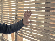 Hand touching wattle and daub wall. A young persons hand is touching an old wattle and daub wall Royalty Free Stock Photo
