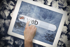 Hand touching web on search bar on tablet screen Royalty Free Stock Photo
