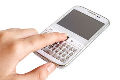 Hand touching white smart phone Stock Images