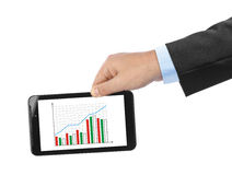 Hand with touchpad pc and business diagram Stock Photography