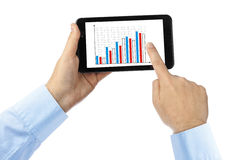 Hand with touchpad pc and business diagram Royalty Free Stock Images