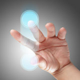 Hand and Touchscreen Technology Stock Photos