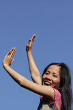 Hand towards blue sky Stock Image
