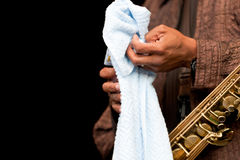 Hand, towel and saxophone stock image