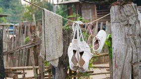 Hand towel with shoes stock photo