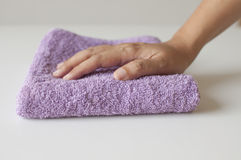 Hand with towel. Royalty Free Stock Image