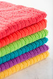 Hand towels in rainbow colors (yellow, purple, blue, green, oran Stock Images