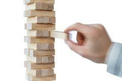 Hand and tower of wooden blocks stock images