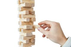 Hand and tower of wooden blocks royalty free stock image