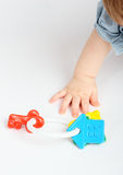 Hand and toy Royalty Free Stock Photos