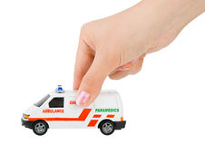 Hand with toy ambulance car Royalty Free Stock Images