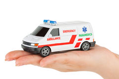 Hand with toy ambulance car Stock Photography