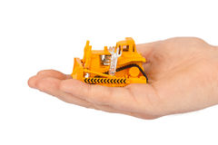 Hand with toy bulldozer Royalty Free Stock Photo