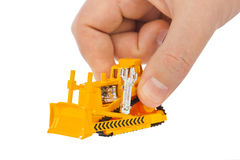 Hand with toy bulldozer Royalty Free Stock Image